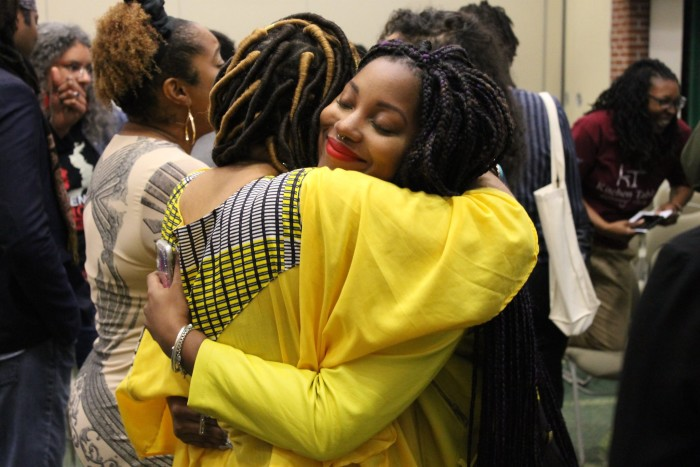 Camonghne Felix and Natasha Oladokun embrace after the Fellows Reading.